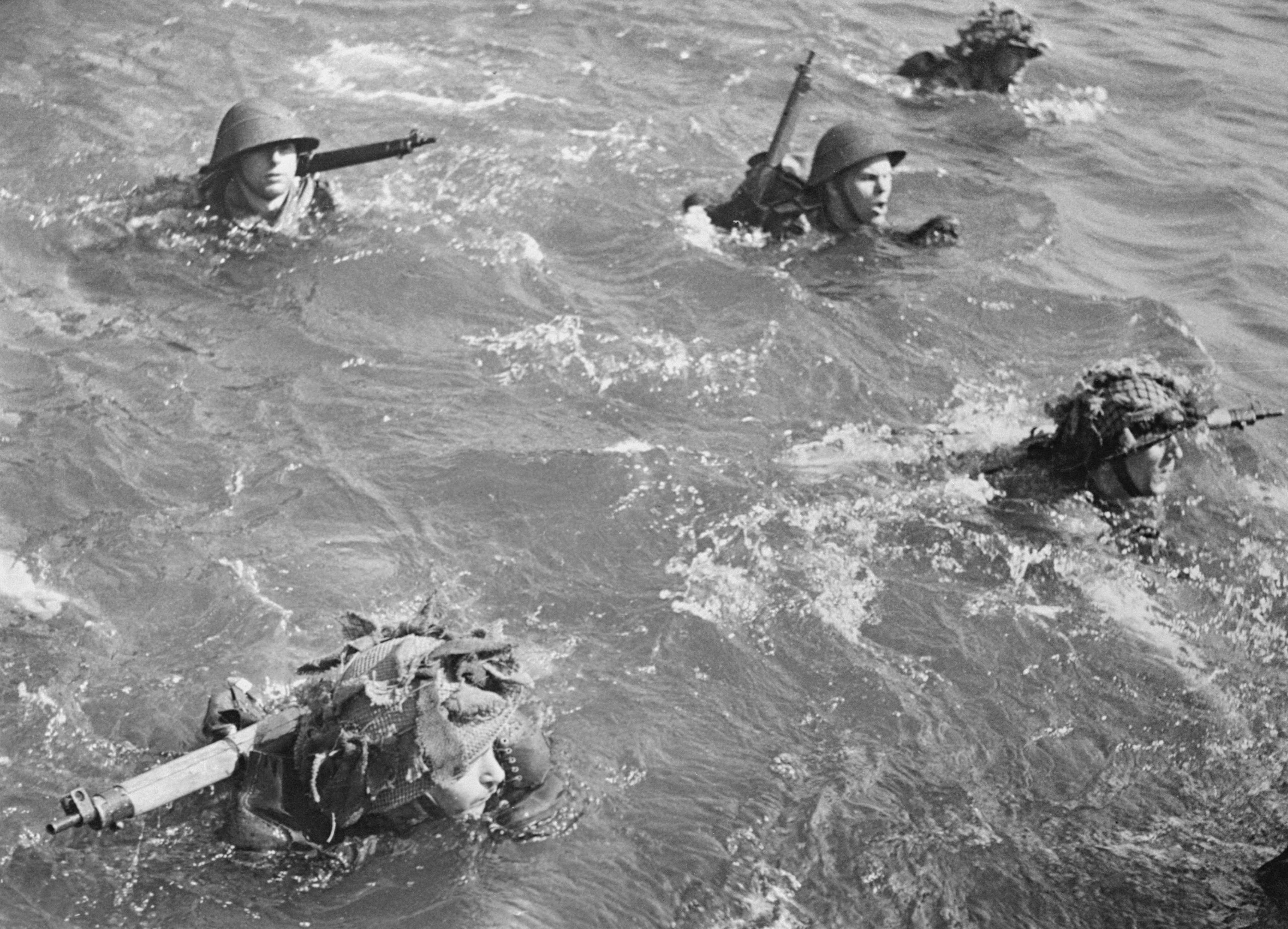 """British troops learn to swim in full kit on a training course in May 1944. """"A blind man could see something big was about to happen,"""" said one soldier. (Image by Getty Archives)"""