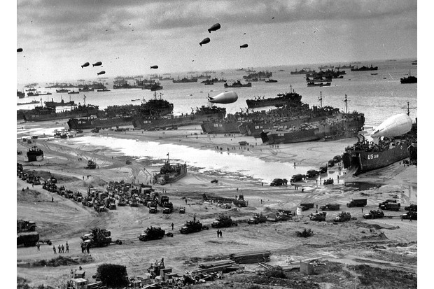 Invasion force: men and materiel come ashore. By the end of D-Day, some 156,000 Allied troops had established a toehold on the Normandy coastline. (Photo by Universal History Archive/UIG via Getty Images)