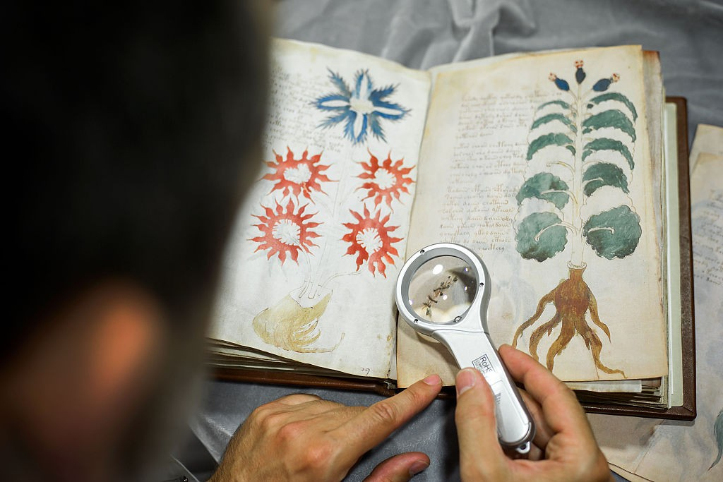 A Spanish publisher works on cloning the illustrated codex hand-written manuscript Voynich. (Photo by CESAR MANSO/AFP/Getty Images)