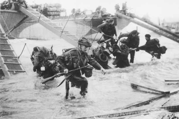 Troops from the 48th Royal Marines at Saint-Aubin-sur-Mer on Juno Beach, Normandy, France, during the D-Day landings, 6 June 1944. (Photo by Hulton Archive/Getty Images)