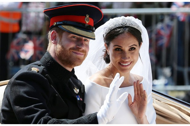 Prince Harry received the titles of Duke of Sussex, Earl of Dumbarton and Baron Kilkeel upon his marriage to Meghan Markle in 2018. (Image by AARON CHOWN/AFP/Getty Images)