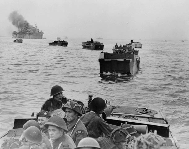 Infantrymen of the Royal Winnipeg Rifles in Landing Craft Assault (LCAs) en route to land at Courseulles-sur-Mer, France. (Credit: Canada. Dept. of National Defence / Library and Archives Canada / PA-132651)