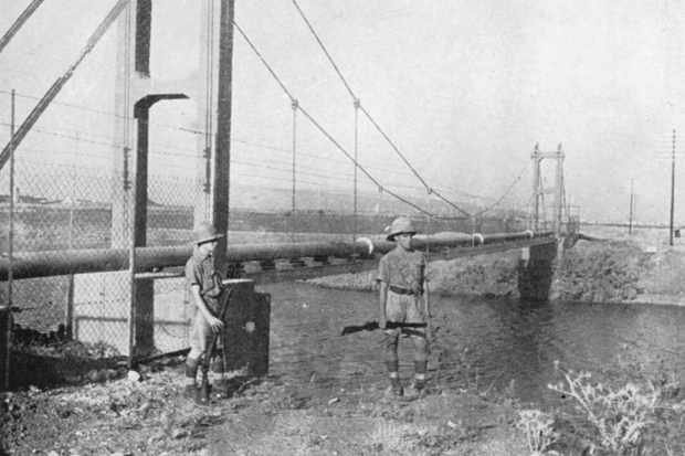 British soldiers guard an oil pipeline, leading from Iraq to Palestine, at the Kishon river, in what is now Israel, in 1941. When Baghdad was retaken, the flow of oil was restored. (Image by Bridgeman)