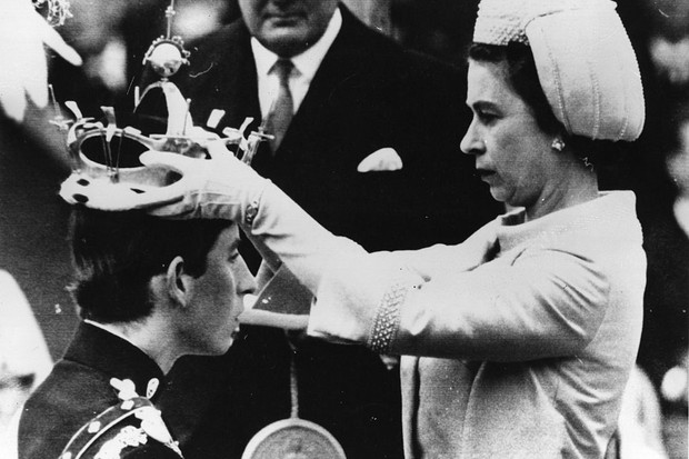 Queen Elizabeth II invests her eldest son, Prince Charles