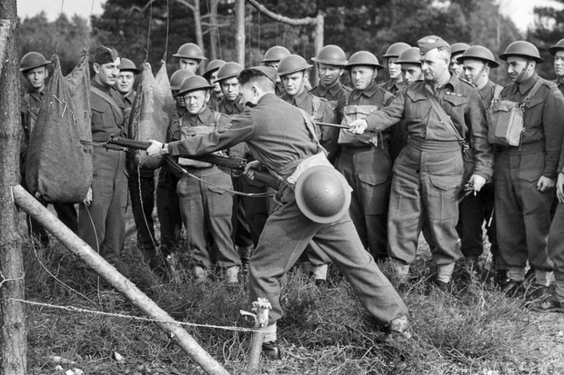 Second World War soldiers learning bayonet skills.