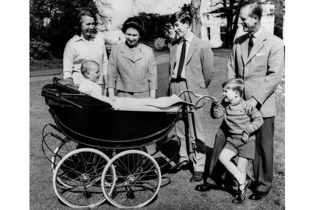 Photo taken on April 21, 1965 at Frogmore House in Windsor, Berkshire shows The British Royal Family: (from L to R) Princess Anne, Britain's Queen Elizabeth II, Prince Charles, Prince of Wales, Prince Philip, Duke of Edinburgh, Prince Andrew, Duke of York smiling at Prince Edward, Earl of Wessex, in his cradle. (Photo by STRINGER / CENTRAL PRESS / AFP) (Photo credit should read STRINGER/AFP/Getty Images)