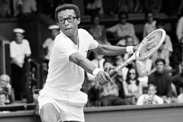 Arthur Ashe in action at Wimbledon, where he won the men's singles title in 1975. (Photo by Ed Lacey / Popperfoto / Getty Images)