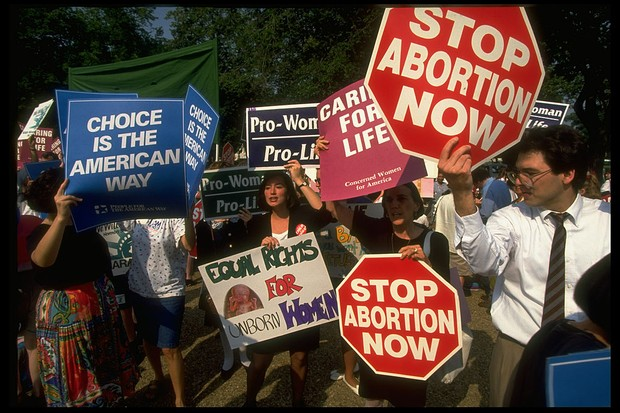 Pro-choice and pro-life advocates outside the Supreme Court in the 1970s, following the Roe v Wade decision. (Photo by Diana Walker//The LIFE Images Collection via Getty Images)
