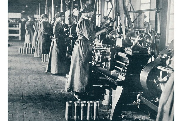 Munition workers at their lathes in a Scottish mill, c1914. (Photo by Print Collector/Getty Images)