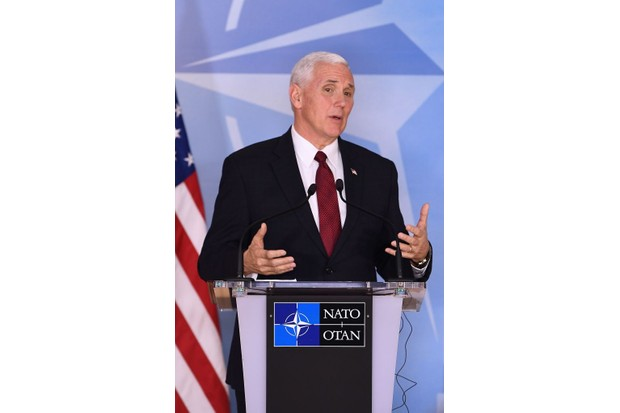 US vice-president Mike Pence speaks after a Nato meeting