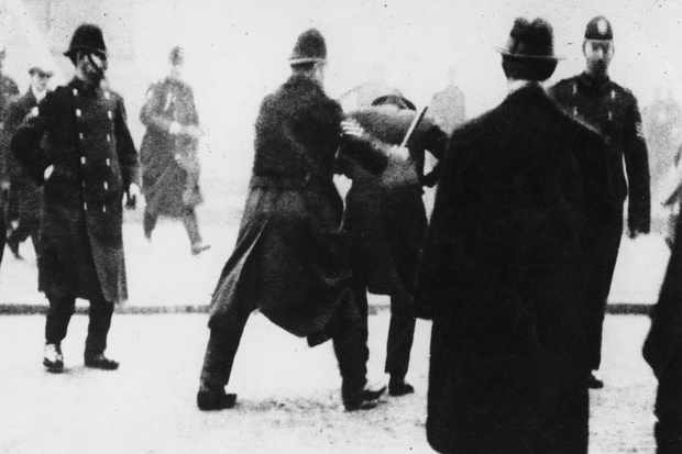 A police officer uses his baton on a protester in Glasgow, 1919