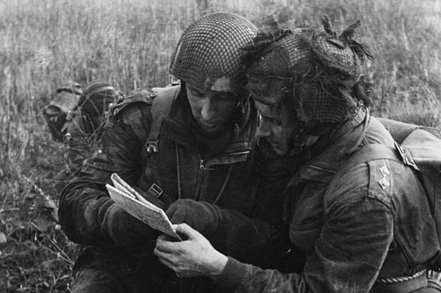Members of a British parachute regiment consult their maps during a training exercise just weeks before D-Day. Training was intensive – and dangerous. (Photo by Haywood Magee/Picture Post /Hulton Archive/Getty Images)