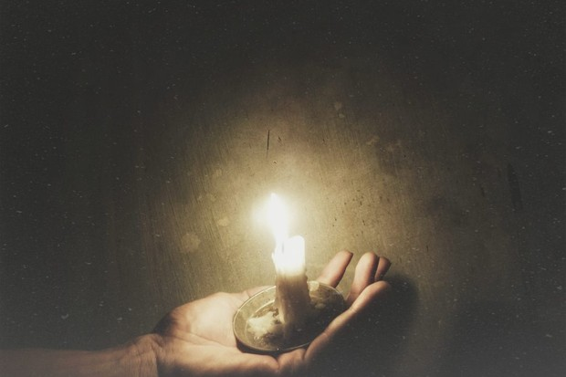Picture of a hand holding a candle