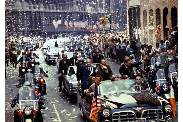 A ticker-tape parade showing the Apollo 11 astronauts