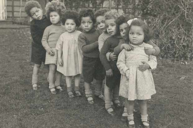 Uncertain futures: Children of black American servicemen and white British women often spent time in case, such as this group photographed at Holnicote House in Somerset. (Photo by Lesley York – Author provided)