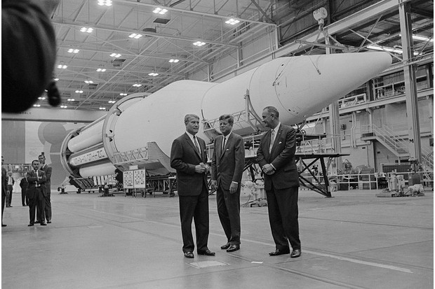 US President John F Kennedy and Vice President Johnson in front of a rocket