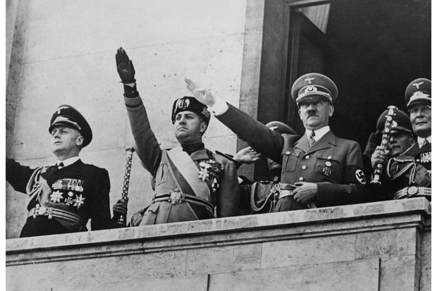 German Foreign Minister Joachim von Ribbentrop (far left), pictured with Adolf Hitler and Hermann Goering, making the Nazi salute before a Berlin crowd in 1939. (Photo by Central Press/Hulton Archive/Getty Images)