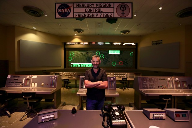 BBC Radio Cymru presenter Tudur Owen in the mission control room in Houston, designed by Tecwyn Roberts. (Image by BBC/Rocket Man: NASA's Welsh Hero)