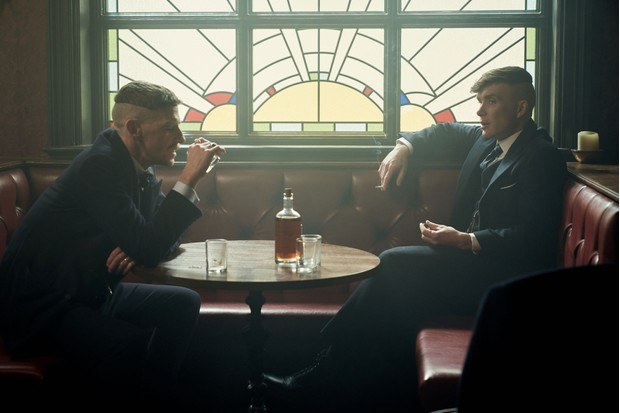 Tommy and Arthur Shelby drinking