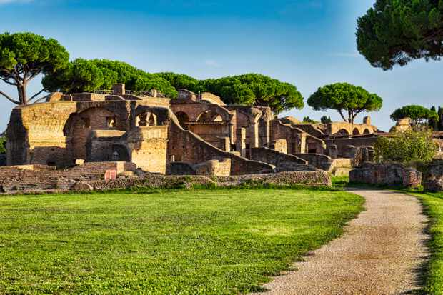 Roman ruins in Ancient Ostia with the tenements of Serapide