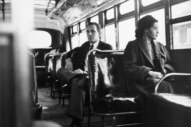 Rosa Parks rides on a Montgomery bus