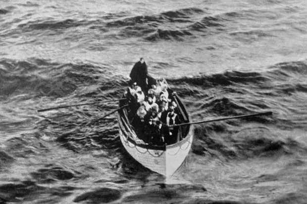 An emergency cutter lifeboat carrying a few survivors from the Titanic, seen floating near the rescue ship Carpathia on the morning of 15 April 1912. Why were so few on board the Titanic rescued? (Photo by Ralph White/Corbis via Getty Images)