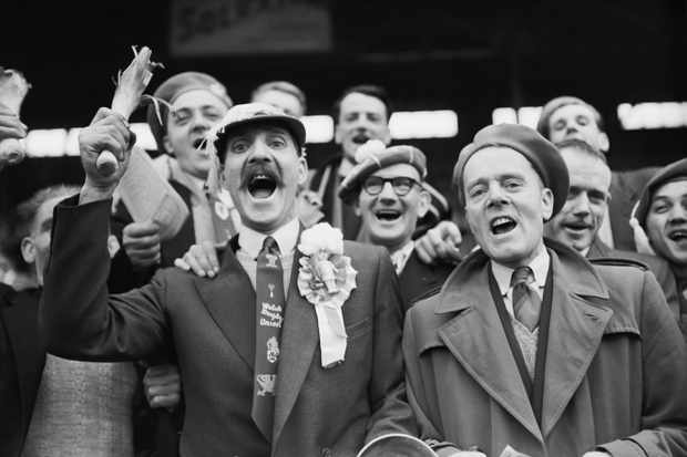 Wales' fans celebrate victory at the 1957 Five Nations Tournament, France vs Wales, holding the Welsh symbol, the leek. (Photo by Universal/Corbis/VCG via Getty Images)