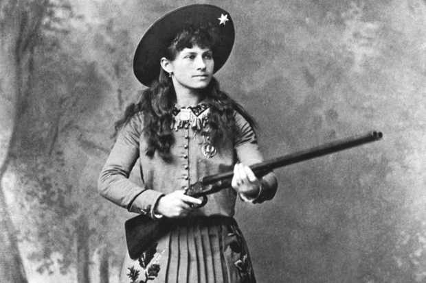A portrait of sharpshooter Annie Oakley holding a shotgun, mid 1880s. (Photo by Underwood Archives/Getty Images)