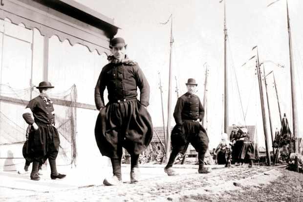 19th-century men in traditional dress, Marken Island, Netherlands.