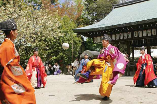 Men play kemari ball game