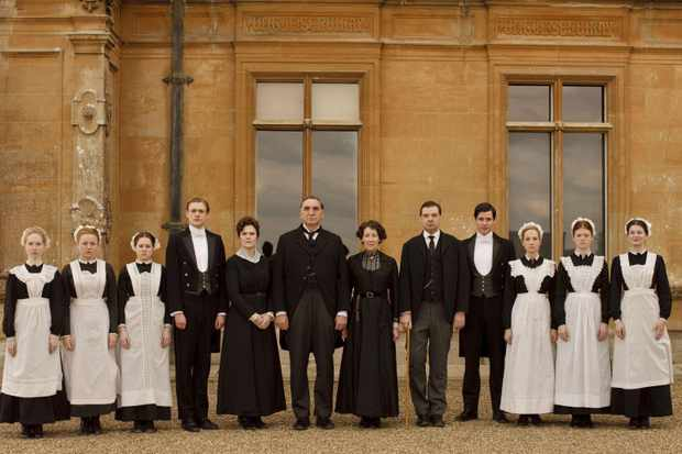 The cast of Downton Abbey in front of Highclere Castle
