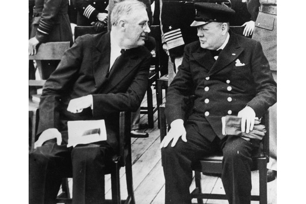 American president Franklin Delano Roosevelt (1882 - 1945) meets British prime minister Winston Churchill (1874 - 1965) for a church service on board the HMS Prince of Wales in Placentia Bay, Newfoundland, August 1941. They have convened for the Atlantic Conference to negotiate the Atlantic Charter. (Photo by Fox Photos/Hulton Archive/Getty Images)