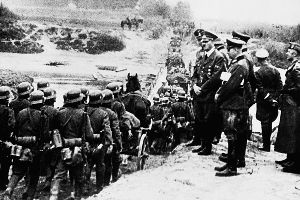 Adolf Hitler watches German troops march in central Poland
