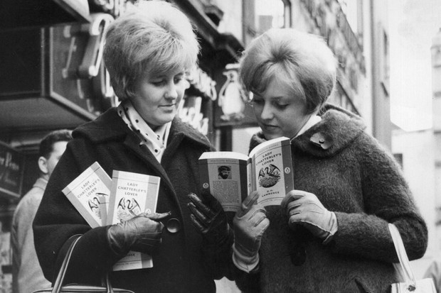 Two women outside a book shop in Leicester Square, London, with paperback copies of 'Lady Chatterley's Lover' by D H Lawrence, after a jury at the Old Bailey decided that it was not obscene. (Photo by Keystone/Getty Images)