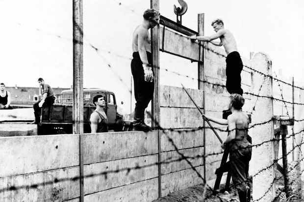 Setting a trap: East German soldiers construct the Berlin Wall, 13 August 1961. The barrier was an attempt to stop the flood of Germans fleeing from east to west – yet, as scores of audacious escape bids attest, it didn't entirely succeed. (Photo by Keystone-France/Gamma-Keystone via Getty Images)