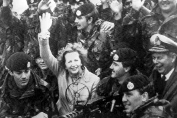 "Margaret Thatcher surrounded by British soldiers of the 1st Battalion, Royal Hampshire Regiment, during a surprise visit to the Falkland Islands, January 1983. Britain has ""ceased to be a nation in retreat,"" declared the prime minister in the wake of the victory over Argentine forces."