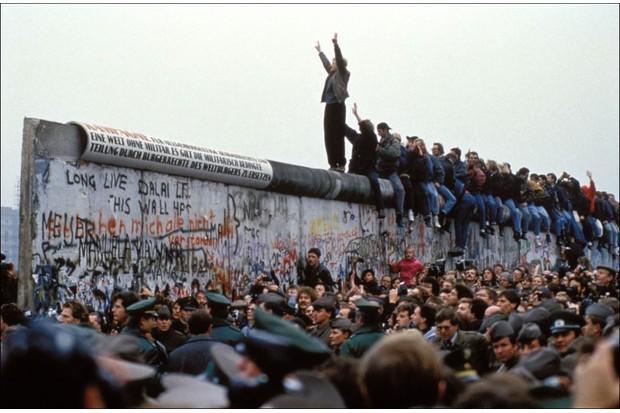 November 1989: Celebrations on the Berlin Wall. (Photo by Pool CHUTE DU MUR BERLIN/Gamma-Rapho via Getty Images)