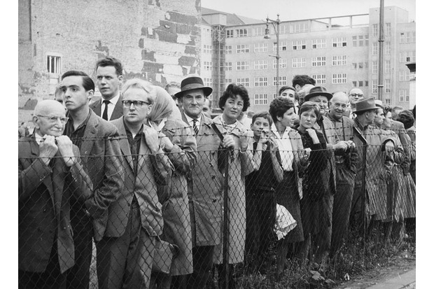 Crowds of Germans wait for friends and relatives to arrive from the opposite sector on a day the wall is open. (Photo by Three Lions/Getty Images)