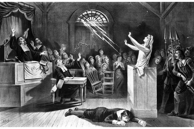 17th century: A young woman stands accused of witchcraft. (Photo by MPI/Getty Images)