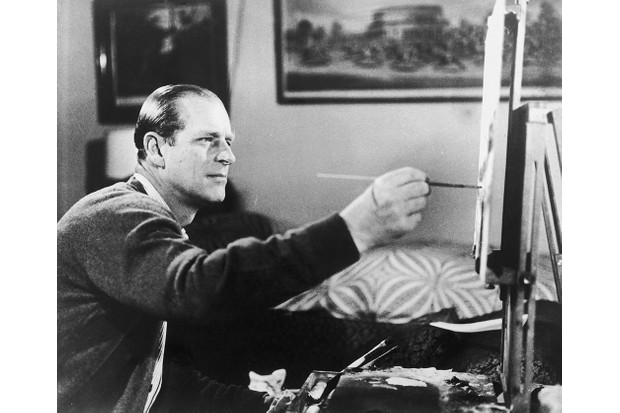 Prince Philip believed that television could be a useful tool for promotion of the monarchy. Here he paints in a scene from the 1969 documentary. (Photo by Keystone/Hulton Archive/Getty Images)