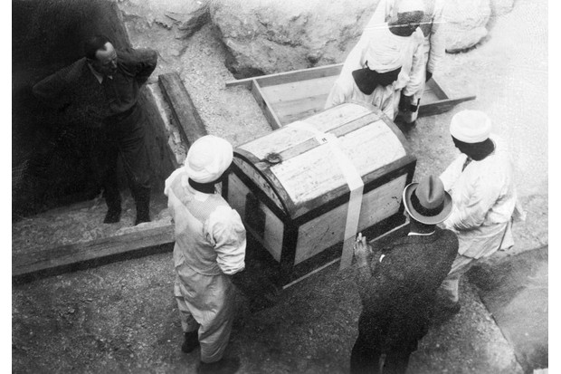 Men carry one of many chests from Tutankhamun's tomb, 1923