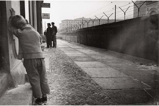c1961/62: A young boy leans against the Berlin Wall. (Photo by Imagno/Getty Images)