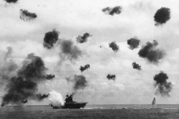 'Yorktown' sustains a hit during the battle of Midway. The US aircraft carrier sank three days later but, by then, the Japanese had accepted that their attempt to land a war-winning blow had failed. (Photo by © CORBIS/Corbis via Getty Images)