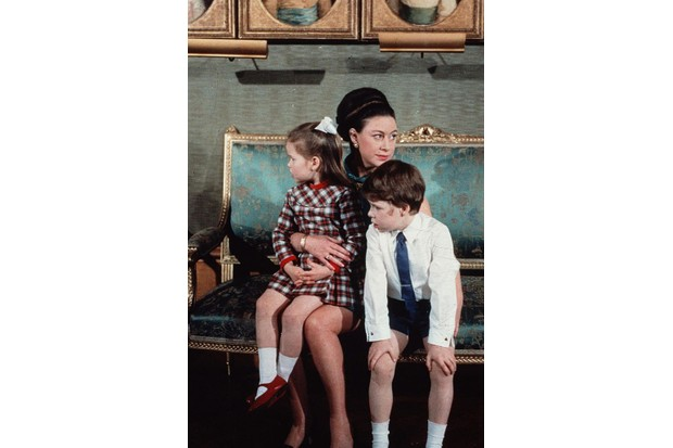 Princess Margaret sits in 1970 with her children Lord Linley and Lady Sarah Armstrong-Jones. (Photo by Getty Images)