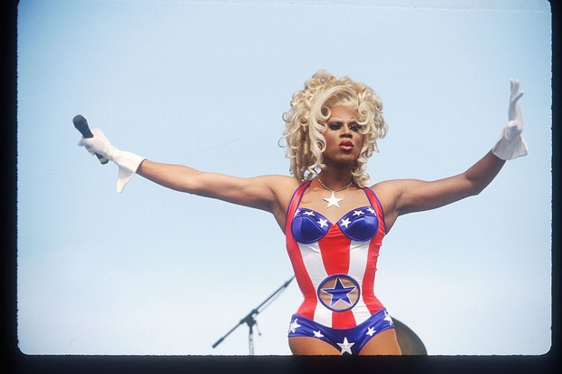 RuPaul – who produces and presents the reality TV show bearing his name – performs during a Gay Rights March in Washington, DC, April 1993. Over 500,000 LGBTQ+ activists and allies participated in a gathering organised to end discrimination. (Photo by Porter Gifford/Liaison)