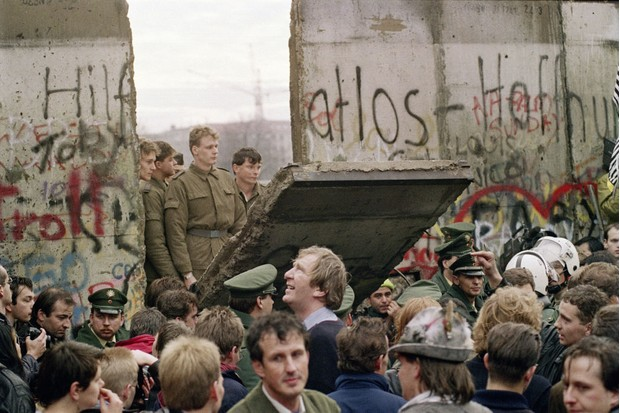 Early November 1989: Germans living in West Berlin crowd in front of the Berlin Wall to watch guards open a new crossing point near Potsdamer Platz