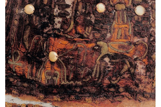 Decorative appliqué needlework on a linen garment found in the tomb of Tutankhamun.