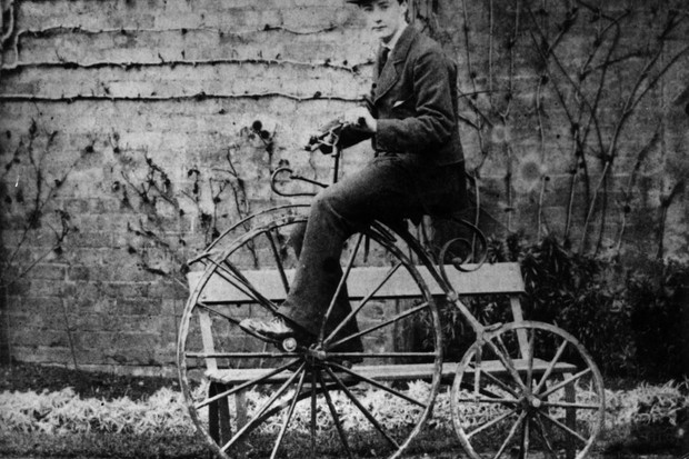 Photo of a man on a penny-farthing