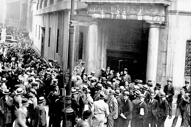 Scores of people milled about the entrance to the Stock Exchange on 24 October 1929, as the market went through the greatest shake up in its history. It was a light tremor heralding the earthquake to come. (Photo by NY Daily News Archive via Getty Images)