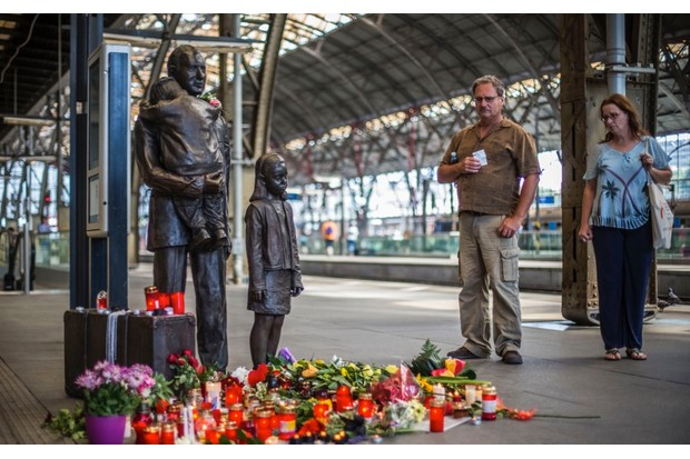 A statue commemorating Nicholas Winton and his efforts to save 669 children stands in Prague's railway station (Photo by Matej Divizna/Getty Images)